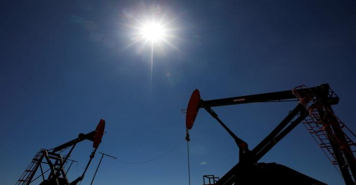 FILE PHOTO: Oil rigs are seen at Vaca Muerta shale oil and gas drilling, in the Patagonian
