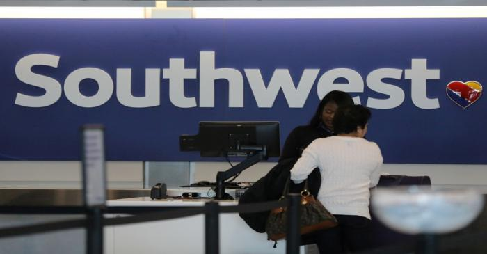 FILE PHOTO: A traveler checks her baggage at the Southwest Airlines terminal at LAX airport in