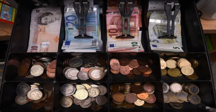 A shop cash register is seen with both Sterling and Euro currency in the till at the border