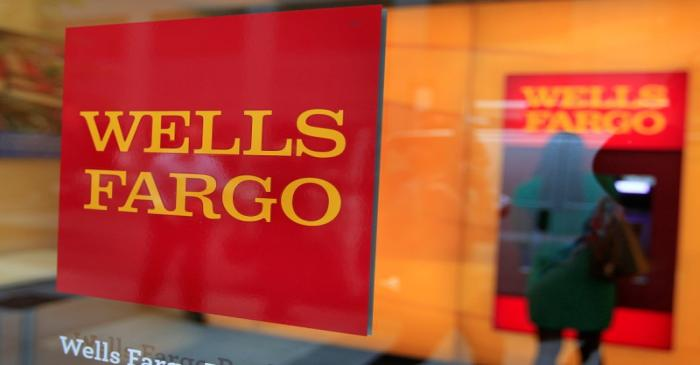 FILE PHOTO: A Wells Fargo sign is seen outside a banking branch in New York