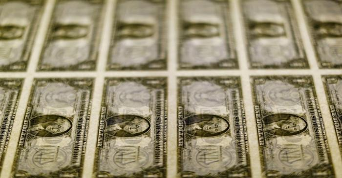 FILE PHOTO: United States one dollar bills seen on a light table at the Bureau of Engraving and