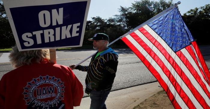 Striking union workers walk the picket line outside the GM Flint Truck Assembly in Flint