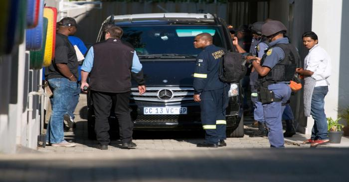 FILE PHOTO: Police raid the home of the Gupta family, friends of President Jacob Zuma, in