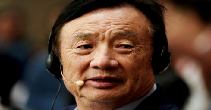 FILE PHOTO: Huawei founder Ren Zhengfei attends a panel discussion at the company headquarters