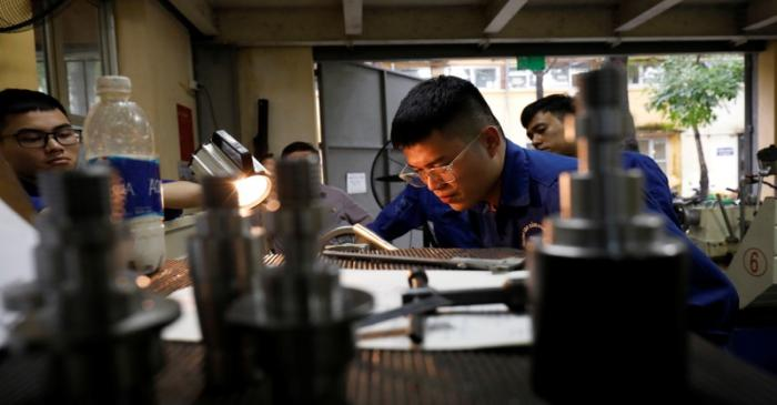 Students practise at a lab of an industrial vocational training college in Hanoi