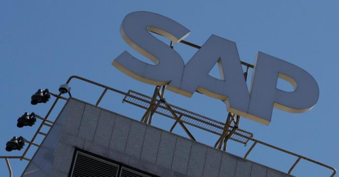 A view shows a sign with the logo of SAP software company on the roof of an office building in