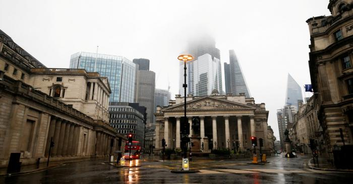 FILE PHOTO: The Bank of England is seen in the financial district during rainy weather in