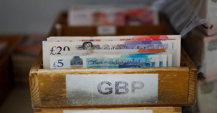 British Pound Sterling banknotes are pictured at the Money Service Austria company's