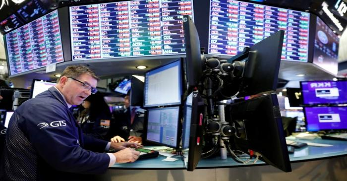 FILE PHOTO: A trader works on the floor of the New York Stock Exchange shortly after the