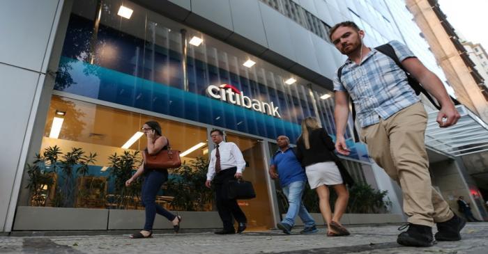 People walk past a Citibank branch in Rio de Janeiro