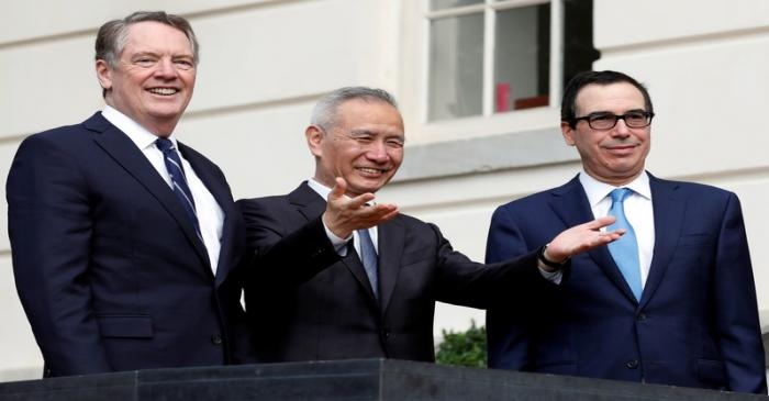 China's Vice Premier Liu gestures to the media between U.S. Trade Representative Lighthizer and