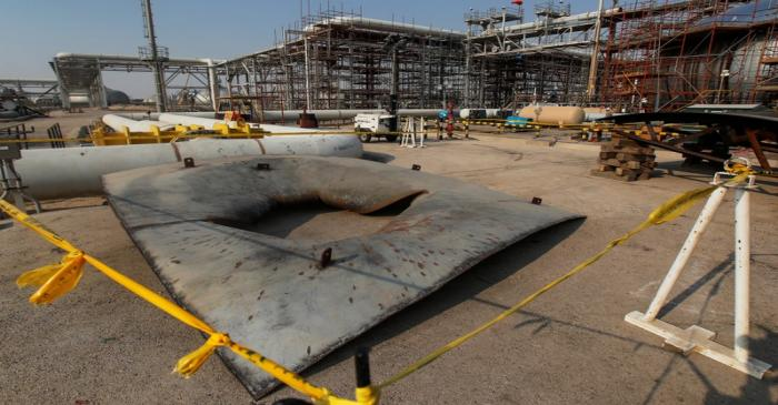 A metal part of a damaged tank is seen at the damaged site of Saudi Aramco oil facility in