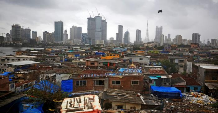 FILE PHOTO: Bird flies across central Mumbai's financial district skyline