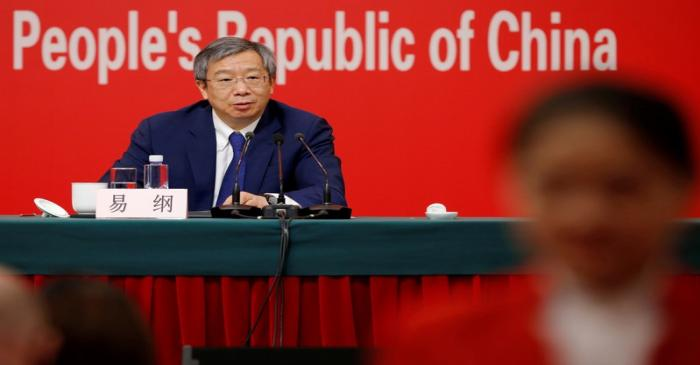 FILE PHOTO: Governor of People's Bank of China (PBOC) Yi Gang attends a news conference on