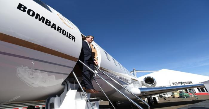 Bombardier Aviation spokesperson Mark Masluch exits the Bombardier Global 6500 business jet at