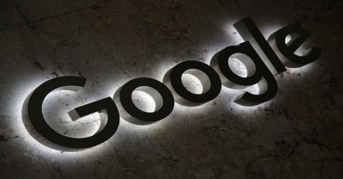 A Google logo is displayed at the entrance to the internet based company's offices in Toronto