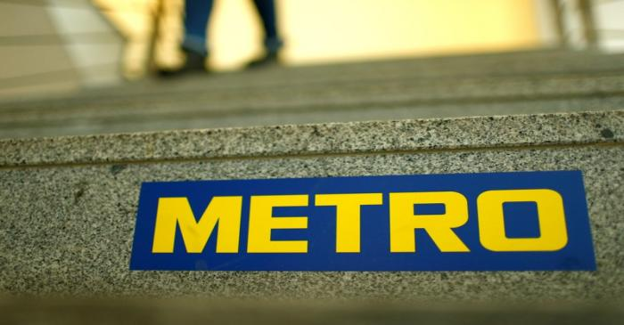 FILE PHOTO: German retailer Metro AG sign is seen on the steps of their headquarters in