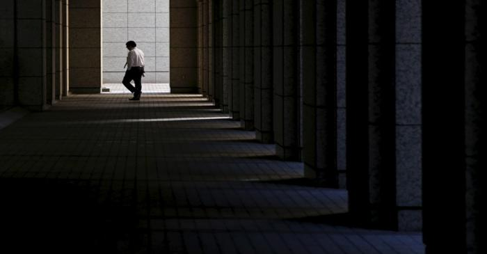 A businessman walks at a business building in Tokyo