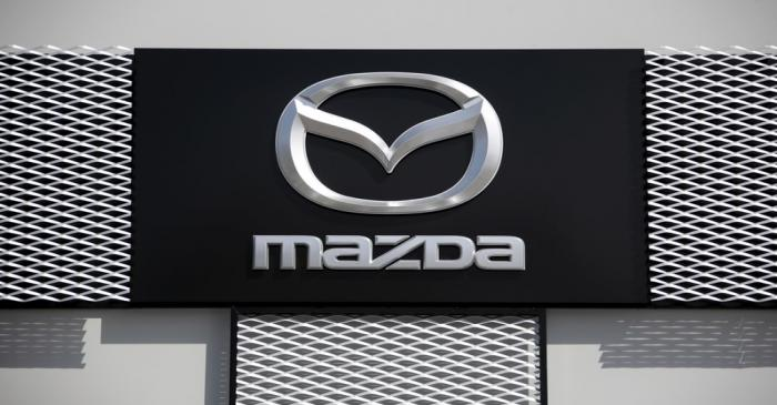 A Mazda company logo is seen outside an automobile dealership inNice