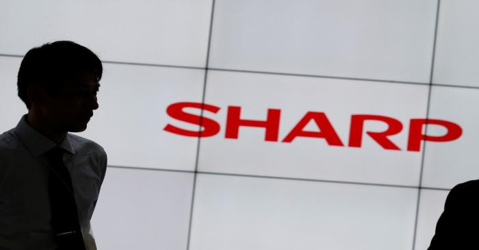 A logo of Sharp Corp is pictured at CEATEC (Combined Exhibition of Advanced Technologies) JAPAN