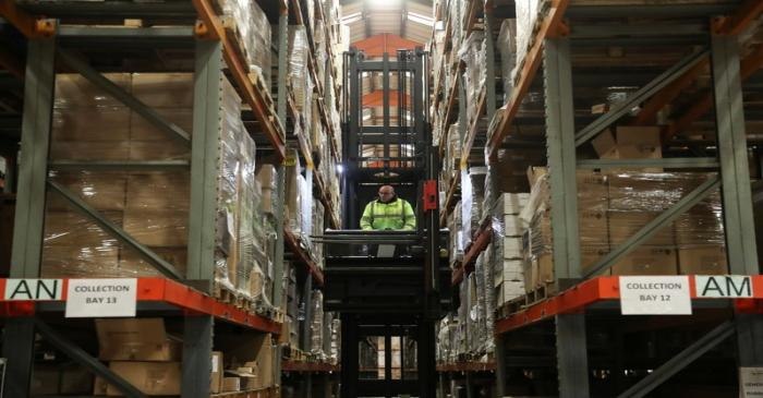 An employee operates a forklift to move goods at the Miniclipper Logistics warehouse in