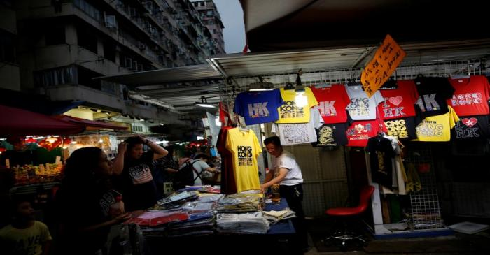 FILE PHOTO: People shop for clothes at a traditional market in Hong Kong