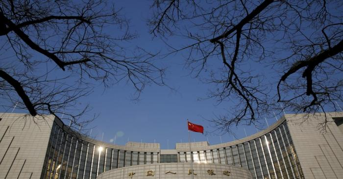 FILE PHOTO: A Chinese national flag flies at the headquarters of the People's Bank of China,