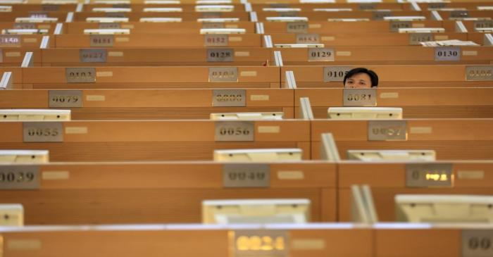 A trader sits on the trading floor at the Shanghai Stock Exchange in Lujiazui Financial Area