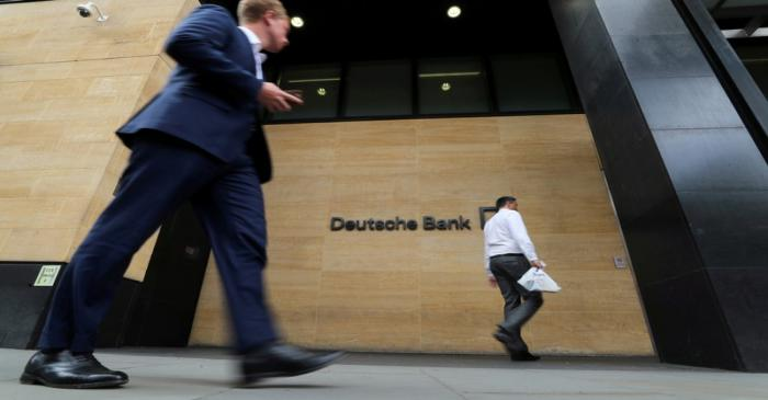 FILE PHOTO: People walk past a Deutsche Bank office in London