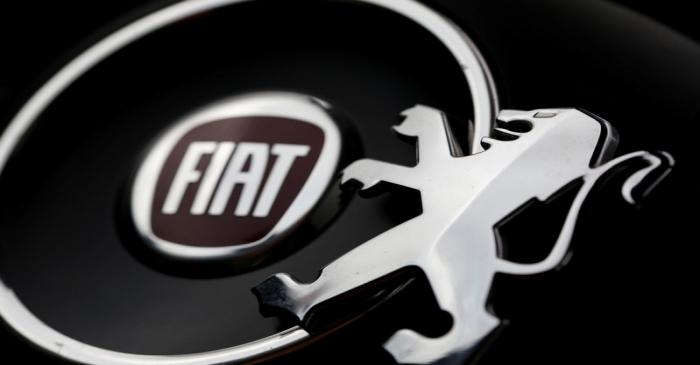 FILE PHOTO: Logos of Peugeot and Fiat are seen in this illustration picture