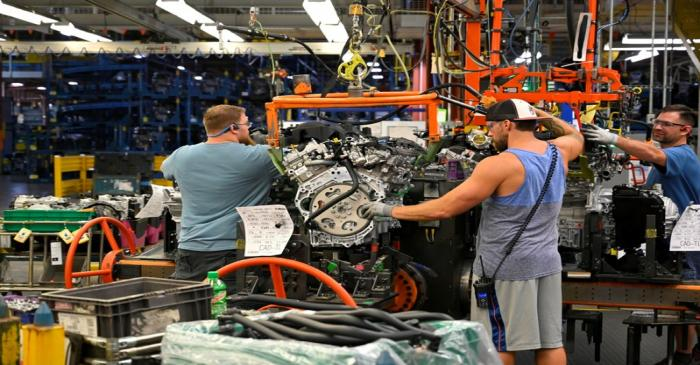 FILE PHOTO: Engines arrive on the assembly line at the General Motors (GM) manufacturing plant