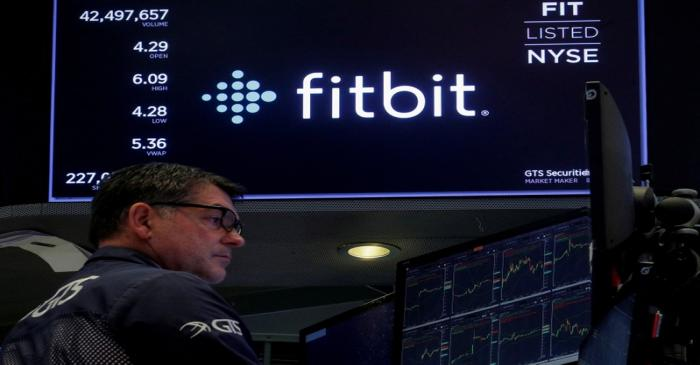FILE PHOTO: The logo for wearable device maker Fitbit Inc. is displayed on a screen on NYSE