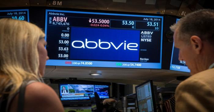 FILE PHOTO: A screen displays the share price for drugmaker AbbVie on the floor of the New York