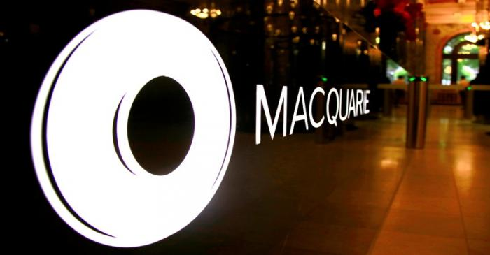 FILE PHOTO: The logo of Australia's Macquarie Group Ltd adorns a desk in the reception area of