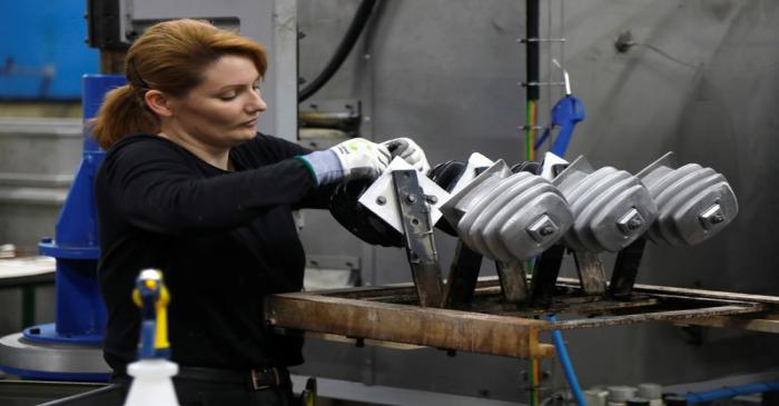 A worker is seen at Plasti-Tremp factory in Menetou-Ratel