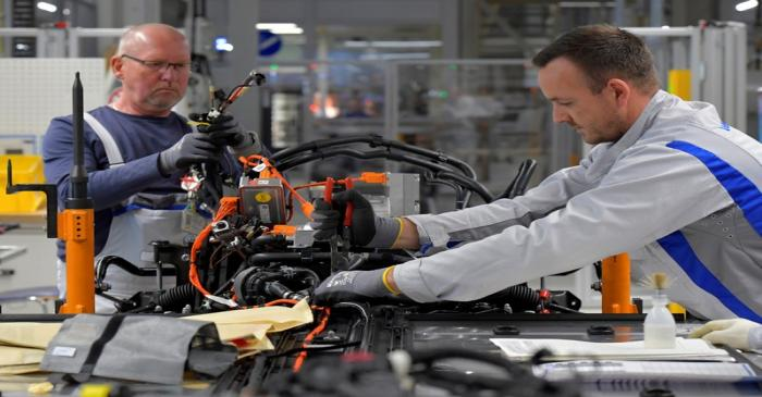 Employees work at a production line of a a new electric Volkswagen model ID.3 in Zwickau