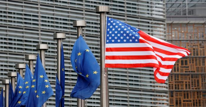 U.S. and EU flags are pictured during the visit of Vice President Pence to the European