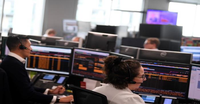Traders are seen at work at Northern Trust offices in London