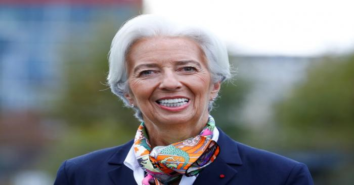 European Central Bank's President Lagarde answers journalists questions as she arrives at the