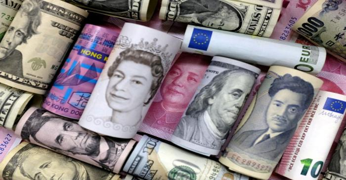 FILE PHOTO: Euro, Hong Kong dollar, U.S. dollar, Japanese yen, pound and Chinese 100 yuan