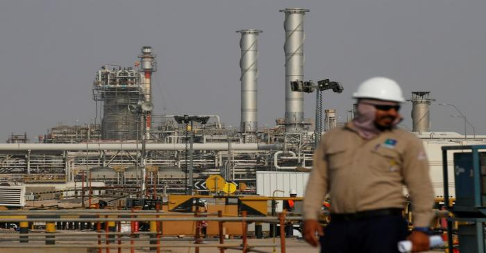 FILE PHOTO: An employee looks on at Saudi Aramco oil facility in Abqaiq