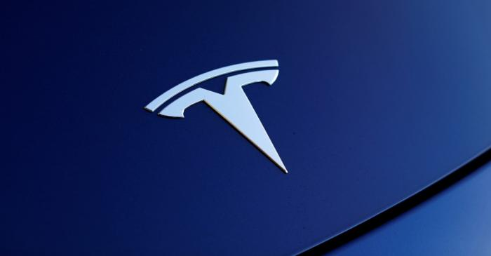 FILE PHOTO: The front hood logo on a 2018 Tesla Model 3 electric vehicle is shown in Cardiff,