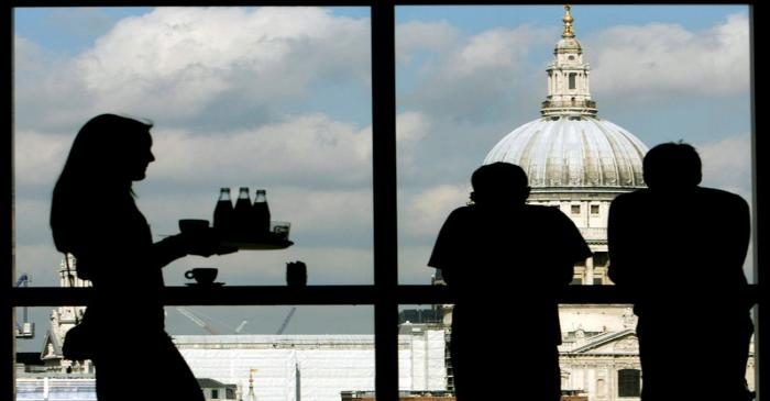 Visitors admire St. Paul's Cathedral from the restaurant floor of the Tate Modern gallery in