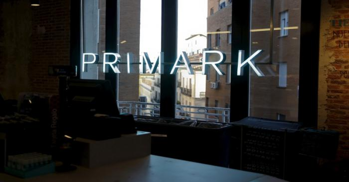 The Primark logo can be seen on windows at Primark's new Spanish flagship store in Madrid,