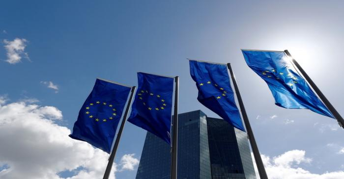 FILE PHOTO: European Union flags flutter outside the European Central Bank (ECB) headquarters