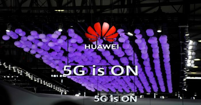 A Huawei logo and a 5G sign are pictured at Mobile World Congress (MWC) in Shanghai
