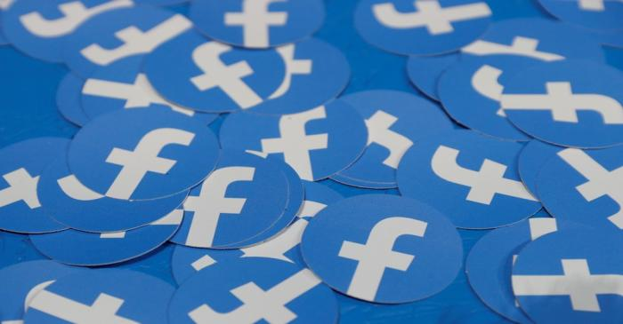 FILE PHOTO: Stickers bearing the Facebook logo are pictured at Facebook Inc's F8 developers