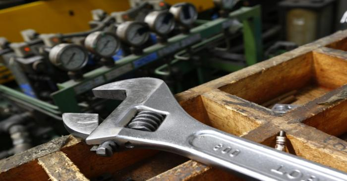 A wrench lies on a workbench at manufacturing firm Sigma UK in Hinckley