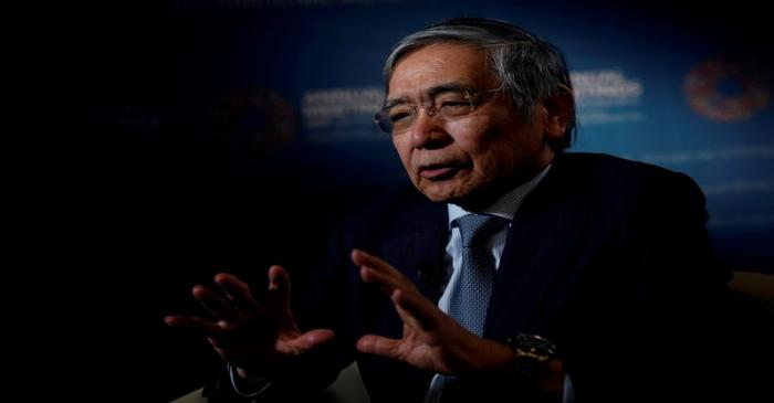 FILE PHOTO: Bank of Japan (BOJ) Governor Haruhiko Kuroda, speaks during an interview with