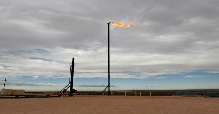 FILE PHOTO: Natural gas flares off at a production facility near Carlsbad